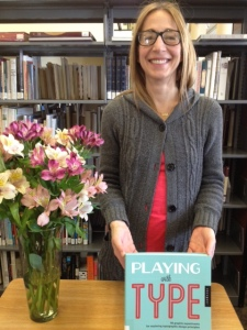 Lara McCormick with her book, Playing with Type
