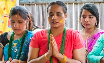 Becky Field,Bhutanese women pray and sing during a Hindu celebration of Lord Krishna's birthday, or Janmashtami, 2012
